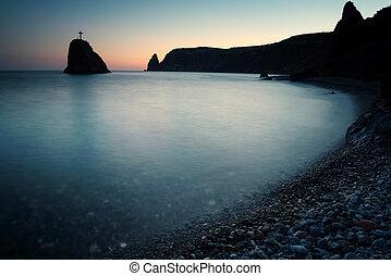 Seashore at sunset. Rock of the holy phenomenon. Fiolent. Crimea