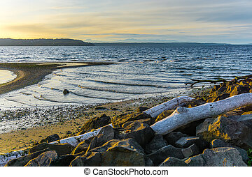 Seashore Sunset Landscape - Waves roll onto the shore at ...