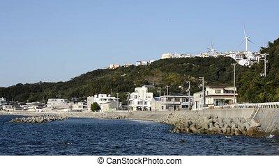 Seashore town scape and wind power plants in Awaji island