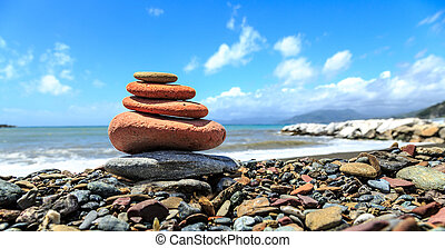 Seashore with stone construction on blue sky background