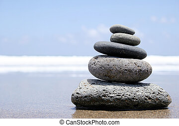 Seashore Zen - Pebble stack on the seashore