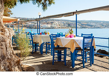 Seaside cafe terrace - Empty greek cafe terrace in...