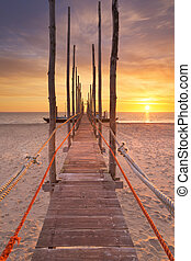 Seaside jetty at sunrise on Texel island, The Netherlands