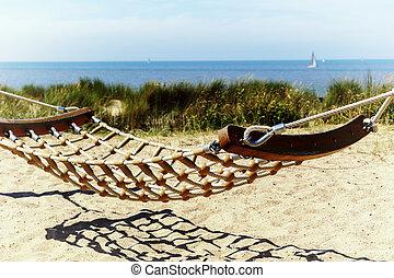 Seaside landscape with hammock. Summer travel background