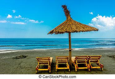 Seaside Lounge Chairs - Seaside beach with lounge chairs and...