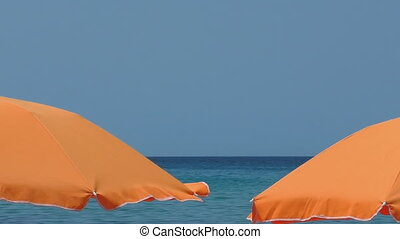 Seaside resort umbrellas and sea