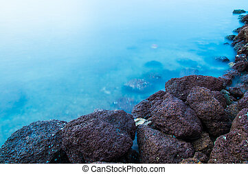 Seaside rocks with beautiful clear blue water