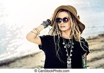 Romantic summer girl in boho style clothes walking along the riverside. Boho, hippie.