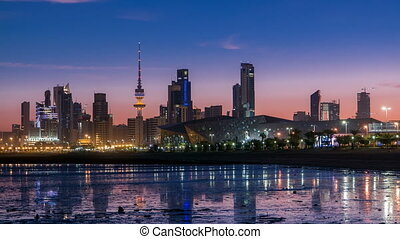 Seaside skyline of Kuwait city from night to day timelapse