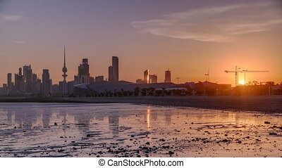 Seaside skyline of Kuwait city sunrise timelapse. Modern...