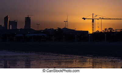 Seaside skyline of Kuwait city sunrise timelapse