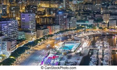 Seaside swimming pool in Monaco night timelapse, buildings...