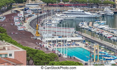 Seaside swimming pool in Monaco timelapse, with people and...