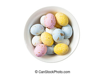 Colorful Easter eggs in a bowl, top view, cut out and isolated on white background