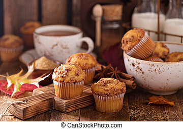 Seasonal cinnamon streusel muffins with tea in a rustic ...