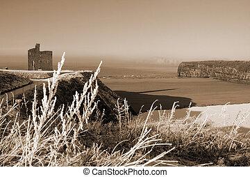seasonal sepia view of ballybunion castle in snow