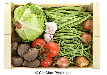 seasonal vegetables in a crate isolated on a white background
