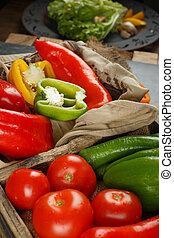 Seasonal vegetables in a rustic tray. Top view.