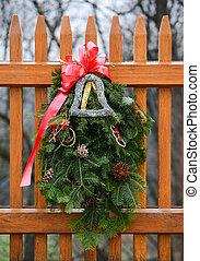 Seasonal Winter Christmas Wreath decoration on a fence