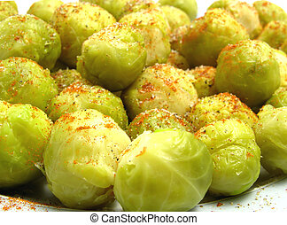 Seasoned brussels sprouts arranged on a plate