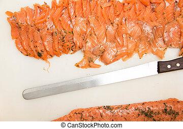 Seasoned pickled salmon slice on Plastic cutting boards