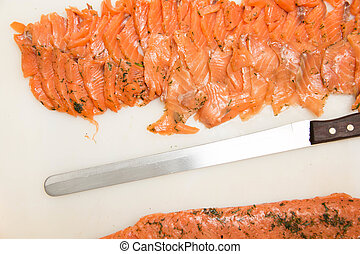 Seasoned pickled salmon slice on Plastic cutting boards
