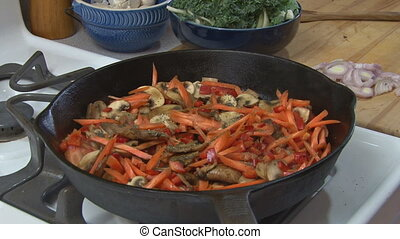 Seasoning and Stirring Veggies - Preparing food - seasoning...