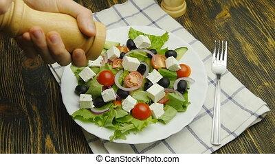 seasoning vegetable salad with salt or pepper at home greek