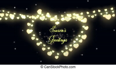 Animation of Seasons Greetings text with glowing fairy lights forming heart and fireworks exploding. Christmas and New Years Eve celebration festivity concept digitally generated image.