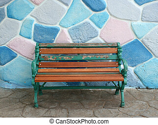 seat and colorful wall