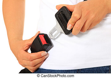 A person fastens the seat belt. All on white background.