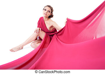Seated beautiful woman in a red dress