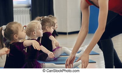 Seated Hamstring Stretch - Close up of choreographer...