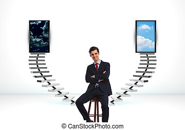 seated happy business man in front of a big decision