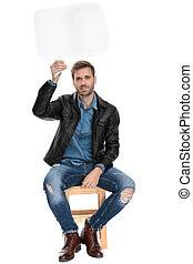 seated man holding a speech bubble overhead