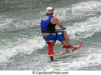 Water skier on a special sit down ski