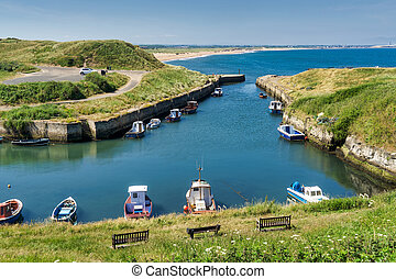 Seaton Sluice Harbour, a small inlet in Northumberland,...