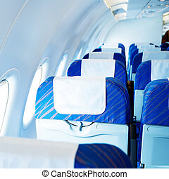 Seats And Folding Table - Empty aircraft seats and windows.