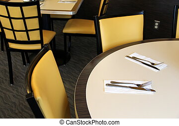 Seats and set tables at diner