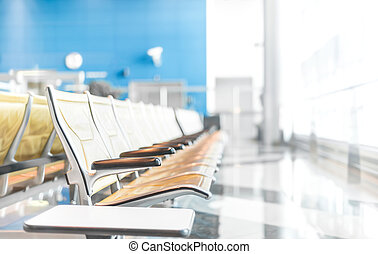 Seats in airport hall waiting for passengers.