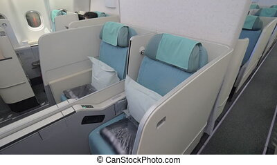Seats in business class cabin - Comfortable empty seats in...