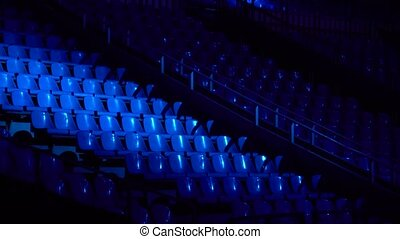 seats in the concert hall in the dark