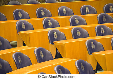Seats in the Dutch Parliament - Rows of empty seats and...