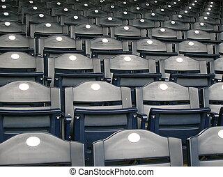 Seats - Rows of empty blue seats.