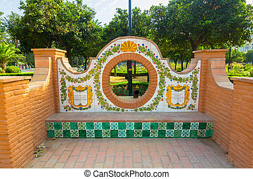 Seats with Andalusian tiles in the Park of Malaga, Spain