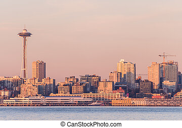 Seattle Bay at sunset over downtown and the Space Needle in the background, Washington, USA.