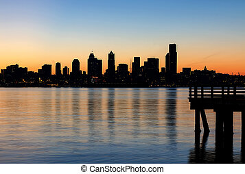 Seattle Skyline Silhouette at Sunrise from the Pier