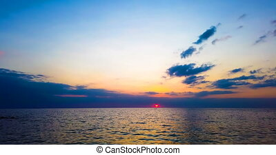 Seautiful sunset over sea with dramatic sky and boats -...
