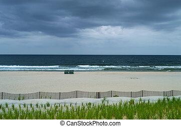 An empty beach on an overcast Summer day on Long Beach Island along the Jersey Shore.