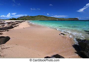 A secluded beach on the Caribbean island of Saint Kitts.